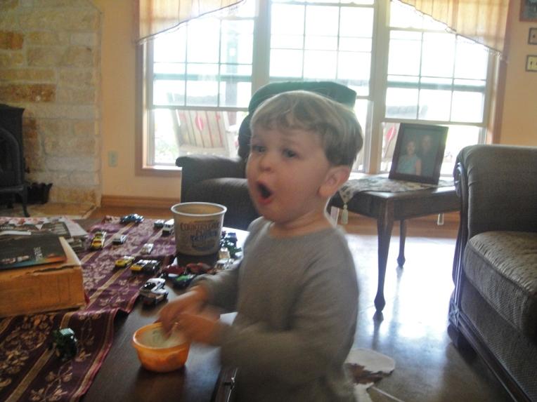 Oliver eating strawberries, he had 3 helpings!!