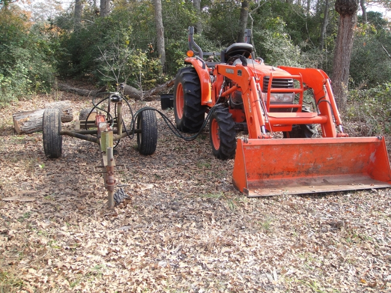 log splitter that is hooked up to the tractor
