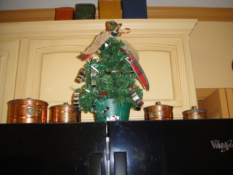 On top of fridge in kitchen - cookie cutters for ornaments!